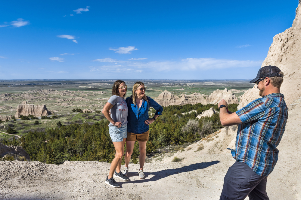 Badlands provide the perfect backdrop for photos. Photo courtesy of South Dakota Tourism